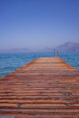 Pier day view (aleksey_kondratiev) Tags: turkey fethiye oludeniz mediterranean sea water blue wave waves seashore rocks sky pier mountain