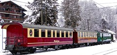 Colorful Goldenpass train in a Swiss winter (somabiswas) Tags: winter snow train switzerland vaud goldenpass chteaudx