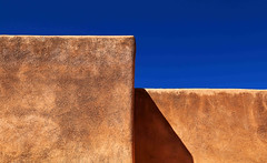 Adobe and Sky (studioferullo) Tags: old blue roof light shadow arizona sky brown house abstract building texture lines sunshine wall architecture contrast rural outside outdoors design pattern shadows desert bright tucson outdoor country sunny bluesky historic line adobe minimalism ochre degrazia