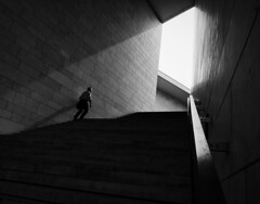 into the light (Georgie Pauwels) Tags: street light blackandwhite lines stairs shadows geometry candid streetphotography olympus