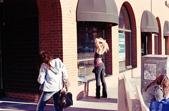 (christait) Tags: street woman canada colour reflection calgary window hair vanity young alberta fixing kodakportra400nc leicacl