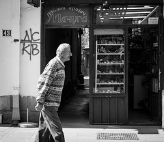 Old Part of Town (Miodrag aki) Tags: old blackandwhite man window senior store streetphotography jeweler