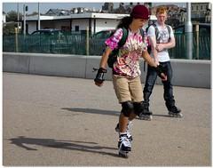Skating down the prom (lovestruck.) Tags: uk boy summer england people man girl seaside pavement candid skating skate nik wirral newbrighton merseyside irishsea 2013 niksofware viveza2
