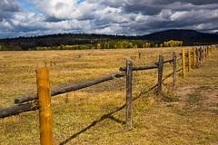 Rural fence in the Tetons National Park (Mysophie08) Tags: clouds rural fence landscape unitedstatesofamerica diagonal wyoming thumbsup lowcontrast infocus grandtetonnationalpark bigmomma gamewinner mediumquality friendlychallenges thechallengefactory yourockwinner herowinner storybookwinner