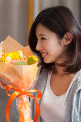 Happy moment receiving bouquet (Apricot Cafe) Tags: male smiling japan female asian japanese togetherness cafe couple internet young lifestyle happiness wireless casual f18 relaxation portlait istockalypse tokyo modelshooting canonef85mmf18usm modelreleaseready artschiyoda33313331 img543939