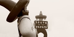 Pedroland (Philip Osborne Photography) Tags: smiling statue fog mexican carolina sombrero southoftheborder