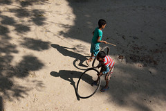 Untitled (Life in Frozen Frames) Tags: light people india game children child play bengal lifeinfrozenframes reemagill tamaghnasarkar 20140205dsc5894