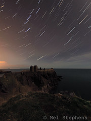 Dunnottar Castle by moonlight (D3101537 E-M1 8.0mm iso400 f3.5 30s x 60) (Mel Stephens) Tags: uk castle night star coast march scotland spring ancient long exposure aberdeenshire olympus structure best fisheye trail nighttime coastal le moonlight 8mm zuiko 43 omd dunnottar stonehaven 2014 em1 q1 startrail m43 fourthirds 201403 mirrorless mmf3 microfourthirds 20140310