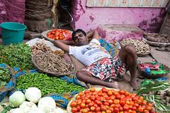 Sleeping (Dick Verton ( more than 13.000.000 visitors )) Tags: travel sleeping india man asia market streetscene varanasi streetview laying streetshot vegetablemarket dickverton