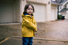 Growing Into His Brother's Raincoat (DavidCallMusic) Tags: yellow child cloudy innocent innocence bluejeans raincoat