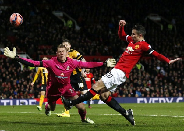 Man United beats 4th tier Cambridge in FA Cup replay