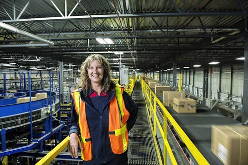 Female Factory Worker in Safety Vest / Travailleuse d'usine dans un gilet de sécurité