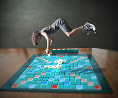 Scrabble Game (elizabethruse) Tags: blue game girl composite youth photoshop children flying aqua turquoise chess surreal games scrabble denim conceptual boardgame