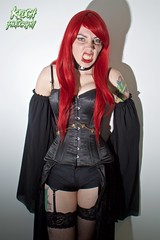 IMG_0250 (Neil Keogh Photography) Tags: blue red orange black green stockings leather female chains comic highheels boots knickers lace vampire esmee wig corset graphicnovel shorts cosplayer suspenders fangs choker caper suspenderbelt stockingssuspenders indiecomic borderfx highheeledbootstattoos salfordcomiccon2016