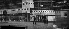 Light Rain Shower (Leanne Boulton) Tags: life street city uk light shadow people urban blackandwhite bw white man black detail building male texture wet water monochrome rain weather architecture umbrella canon walking shower 50mm mono scotland living blackwhite droplets natural humanity outdoor glasgow candid widescreen culture streetphotography streetlife scene human shade crop 7d isolation heavy cinematic raining society depth tone downpour urbanlandscape determination torrential candidstreetphotography