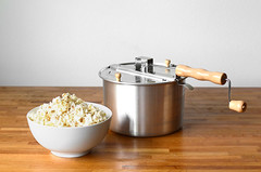 popcorn in white bowl on wooden table (yourbestdigs) Tags: food white hot yellow bag movie table yummy healthy corn junk sweet salt tasty fair bowl pop sugar gourmet pot kettle salty butter snack popcorn carbohydrates treat buttered stir stainless snacking canola kernel refreshment buttery salted kettlcorn