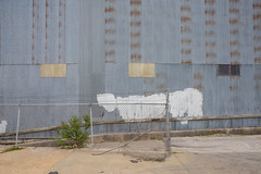 Spending one hour in Topeka, Kansas (Alec C Miller) Tags: street city urban color building art metal wall digital landscape photography paint industrial cityscape fine kansas topeka corrugated topography