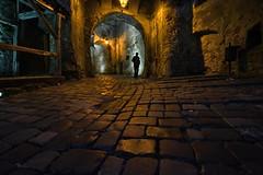 Sighisoara, Romania (ott.geoffrey) Tags: light shadow man cane night dark arch clocktower cobblestone romania sighisoara vlad