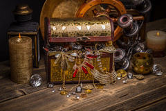 Treasure chest with jewellery (noor.khan.alam) Tags: wood stilllife composition vintage gold wooden necklace coin candle open treasure box chest jewelry diamond full jewellery precious pirate romania bracelet concept crate gem wealth