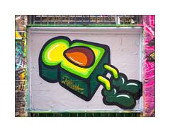 Graffiti (Artista), East London, England. (Joseph O'Malley64) Tags: uk greatbritain england streetart london wall graffiti avocado mural paint britain toast spray british walls cans aerosol brickwork artista eastend eastlondon wallmural barredwindow muralist flyingtoast woodenpanel blockedwindow