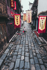 Morning of the ancient town (Picocoon) Tags: china street old morning shop town ancient flag chinese historical streetshot anhui classicarchitecture sanhe