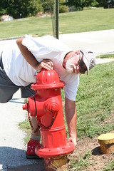 Found It! (eyriel) Tags: red man game hydrant play geocaching