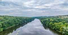 River Pivdennyi Buh (Alex Demich) Tags: trees sky panorama reflection tree green nature water rock stone clouds forest river landscape grey woods rocks stream cloudy horizon buh surface ukraine shore shores overview pivdennyi