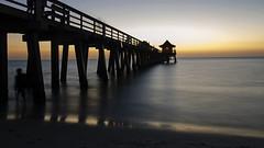 I Stand Alone DSL7074 (iloleo) Tags: light sunset people silhouette timelapse florida le colourful naplespier nikond7000