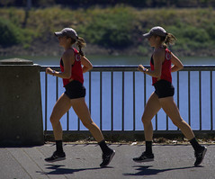 Running Twins (swong95765) Tags: sisters river outfit twins women waterfront path running railing jogging lookalike