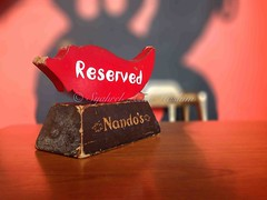 Reserved... (Syahrel Azha Hashim) Tags: light detail colors table restaurant colorful dof bokeh naturallight malaysia handheld shallow reserved nandos iphone iphone5 syahrel