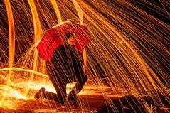 2013-11-22 RVG_0001 Sparkling rain (Ralph on and off) Tags: longexposure red people lightpainting umbrella fire person nikon tripod hero sparks afterdark zeewolde slowshutterspeed longexposuretime nikond300 thephotographyblog ralphvandergeest ralphvandergeestfotografie
