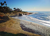 Solitude at La Jolla Cove in San Diego, California (` Toshio ') Tags: ocean california blue sea sky man seaweed beach nature landscape sand rocks surf pacific sandiego cove wave lajolla iceplant palmtree skimboarding lajollacove skimming toshio pickleweed skimboarder