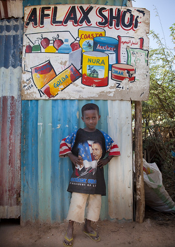 A Boy In Front Of A Painted Advertisment Wearing Obama T Shirt, Hargeisa, Somaliland