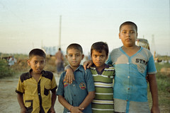 A Below Average Photo (Sheikh Shahriar Ahmed) Tags: boy film boys kids analog pose kid cattle pacific image market bad fujifilm konica dhaka staged bangladesh hexanon 50mmf17 hexanon50mmf17 fujicolorc200 dhakadivision aftabnagar konicaautoreflext3n sheikhshahriarahmed primefilm3650pro3