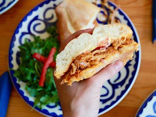 Torta de Cochinita Pibil | ($9.50) Classic Mayan pork shoulder braised in pibil, topped with pickled red onion Photo: Fonda Lola