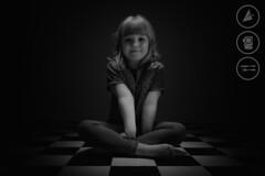 Growing Up (Adrian Court LRPS) Tags: family england bw home monochrome smile hair studio lights mono unitedkingdom megan gb lowkey checkeredfloor monkstonpark