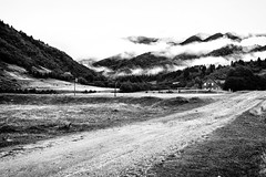 Inviting Mountains (-Michal Slezak-) Tags: road wood bw house mist mountain mountains nature fog clouds contrast analog landscape wooden outdoor sony romania analogue carpathians fagaras wildelife karpaty fogarasze a6000