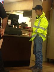 firefighter with moustache (PeepHole of New York) Tags: slicker yellowslicker baseballcap raingear raincoat