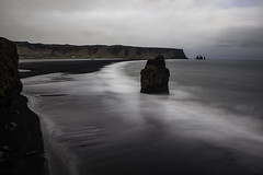 The shore will be where it wants (aerojad) Tags: ocean longexposure travel cliff beach nature landscape blacksand iceland sand waves gloomy cloudy dreary wanderlust southcoast atlanticocean blacksandbeach dyrhlaey daytimelongexposure thesouthcoast iceland2016