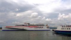 PassingFerries (Hodd1350) Tags: sea clouds olympus passengers dorset ferries sandbanks poole penf pooleharbour zuikolens