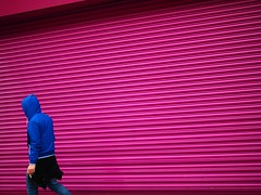 Oxford Street - London Street Photography (Nicholas Goodden) Tags: pink people london lines vanishingpoint hoodie bright cigarette candid streetphotography vivid olympus shutter colourful shopfront urbanphotography walkaway
