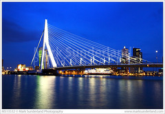 Erasmus Bridge Rotterdam (© Mark Sunderland www.marksunderland.com) Tags: city travel bridge netherlands night river twilight rotterdam europe dusk eu bluehour modernarchitecture floodlit erasmusbrug zuidholland erasmusbridge southholland rivermaas