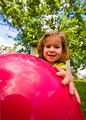 When Your Toys are Larger than You... (mheidelberger2000) Tags: red ball toy kid toddler dof child wideangle 10mm