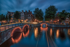 (angheloflores) Tags: city longexposure bridge houses light sky urban netherlands colors amsterdam night clouds lights boat canal cityscape explore trials