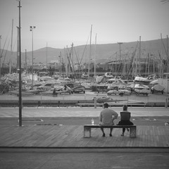 the couple (vfrgk) Tags: blackandwhite bw monochrome marina bench boats couple cityscape sails relaxing greece summertime relaxation staring tranquil seaview calmness piraeus
