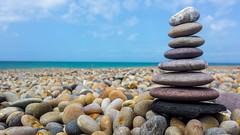 Zen Stones (rolo_061) Tags: blue summer macro beach rock seaside fishing outdoor stones horizon samsung bluesky pebble dorset pebblebeach balance s4 chesilbeach jurassiccoast chesilbank fleetlagoon zenstones mobilephonephotography