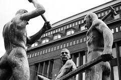 Three smiths statue (markuskoistinen) Tags: blackandwhite bw canonav1 statue 35mm finland helsinki 35mmfilm kodaktrix400 50mmlens