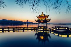 beautiful hangzhou in sunset and ancient pavilion (lds41122) Tags: china city travel bridge sunset sky lake west reflection building tourism water beautiful silhouette japan architecture clouds landscape asian tokyo pagoda twilight ancient scenery colorful asia downtown paradise cityscape tour view dusk background traditional famous hill chinese scenic peaceful tranquility scene tourist calm resort journey hangzhou pavilion leisure oriental visitor enchanting