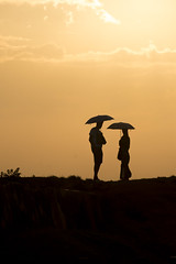 The beginning (Photosightfaces) Tags: sunset love silhouette umbrella couple fort romance sri lanka beginning together srilanka galle srilankan lankan gallefort
