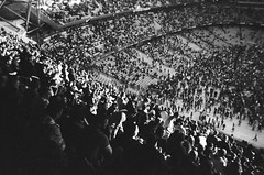 Etihad Stadium, Manchester (iampaulrus) Tags: 35mm film filmisnotdead paulfargher paulfargherphotography ilfordxp2supersingleusecamera ilford xp2 singleusecamera blackandwhite blackwhite bw mono thestoneroses etihad manchester crowd etihadstadium